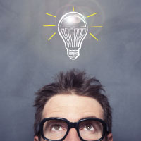 Man looking up with a cartoon light bulb on top of his head