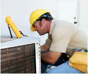 Man fixing AC/HVAC